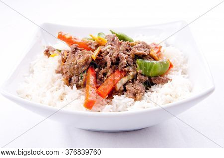 Orange Beef Stir Fry Over White Rice. Made With Flank Steak