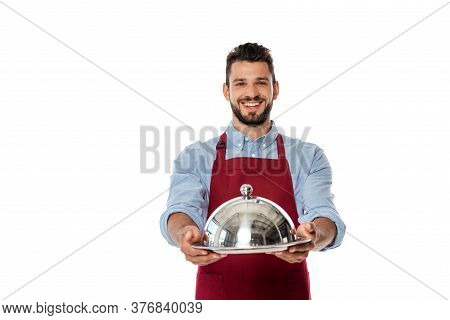 Smiling Waiter In Apron Showing Metal Tray And Dish Cover Isolated On White
