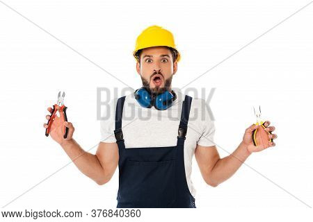 Shocked Workman Holding Pliers And Looking At Camera Isolated On White