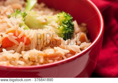 Veleveted Chicken In A Rice And Vegetable Stir Fry