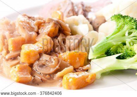 Roasted Leg Of Lamb With Sweet Potato Gnocchi And Mushroom Sauce