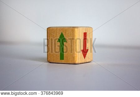 Conceptual Image Of Choice And Direction. Wooden Cube With Arrows Pointing In Opposite Directions. B