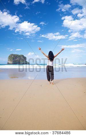 Woman Open Arms In Ballota Beach