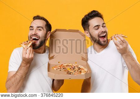 Close Up Of Funny Young Men Guys Friends In White Blank T-shirts Posing Isolated On Yellow Orange Ba