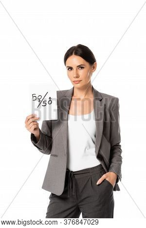 Beautiful Businesswoman Holding Paper With Fifty-fifty Symbols While Standing With Hand In Pocket Is