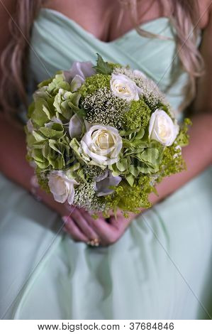 Bridesmaid In Green With Wedding Bouquet