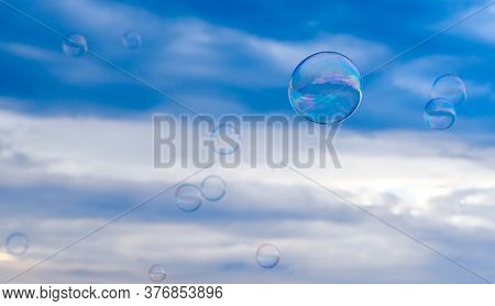 A Lot Of Soap Bubbles Against The Background Of The Patchy Sn To