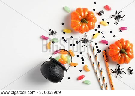 Happy Halloween Holiday Concept. Halloween Decorations, Pot With Sweet Candies, Orange Pumpkins, Spi