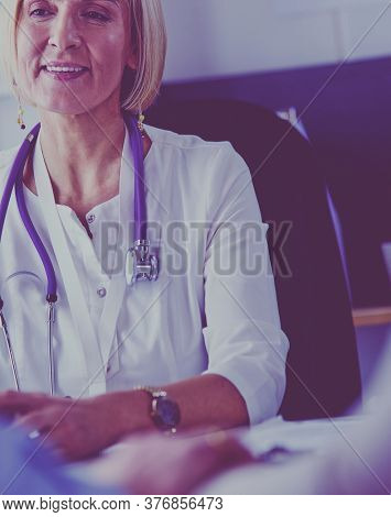 Couple talking to medical specialist, sitting at doctor's office