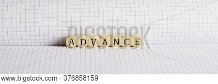 Concept Advance Words Written On A Wooden Block On Notebook. Leadership Concept.