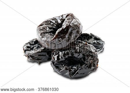 Pile Of Dried Pitted Prunes On White Background With Clipping Path.