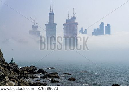 Busan,south Korea - July 20, 2017:  Thick Large And Heavy Mist Blow From The Sea To The Land And Pas
