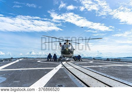 Chonburi, Thailand - July 9, 2020:  Seamen Chalk And Chain An Eurocopter Ec 645 T2  Helicopter On Th