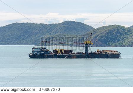 Offshore Barges With Crane And Platform Supply Vessel Mooring Near Island.