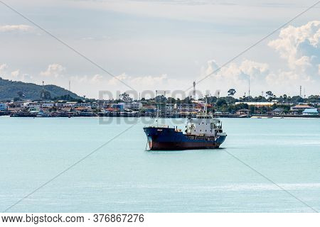 Oil Or Chemical Tankers Anchor In The Harbour Near The Seaside Town In Thailand.
