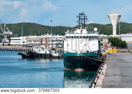 Platform Supply Vessels Or Crews Boat And Tug Boats Moor At Industrial Port.