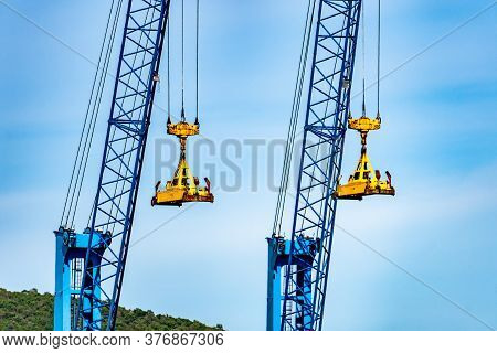 Heavy Lifting Tower Mobile Crane For Loading Cargo In The Small Commercial Sea Port With Moutain Vie