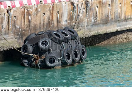 Ship's Or Marine Fender At Deep Sea Port For Mooring The Ship Made From Cylinder Shape Rubber And Co