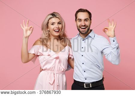 Funny Young Couple Two Guy Girl In Party Outfit Celebrating Posing Isolated On Pastel Pink Backgroun
