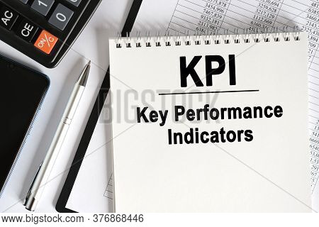 On The Table Lies A Smartphone, A Calculator And A Notebook With The Inscription- Kpi. Key Performan