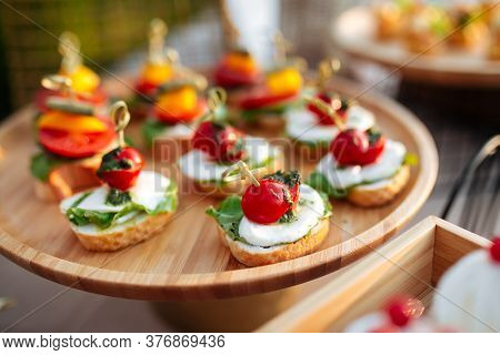 Closeup On Banquet Tappas Canape With Mozzarella Tomatoes And Pesto Sauce