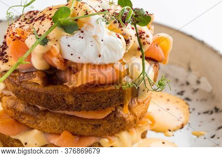 Closeup On Salmon Cake With Poached Egg Cheese And Condiments