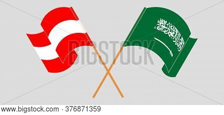 Crossed And Waving Flags Of Austria And The Kingdom Of Saudi Arabia. Vector Illustration