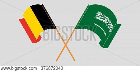 Crossed And Waving Flags Of Belgium And The Kingdom Of Saudi Arabia. Vector Illustration
