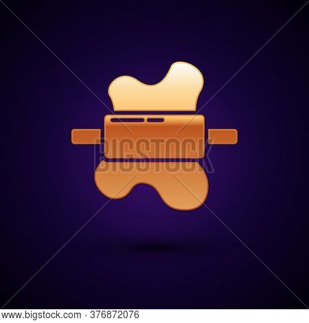 Gold Rolling Pin On Dough Icon Isolated On Black Background. Vector