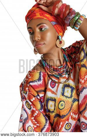 Portrait Of A Young And Lovely African American Black Woman In The National African Clothes Over Whi