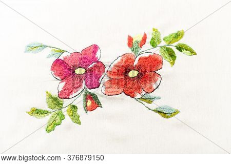 Embroidery With Colorful Flowers. Close Up. Copy Space.