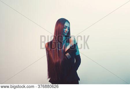 High Fashion Portrait Of Elegant Woman In Black Dress.