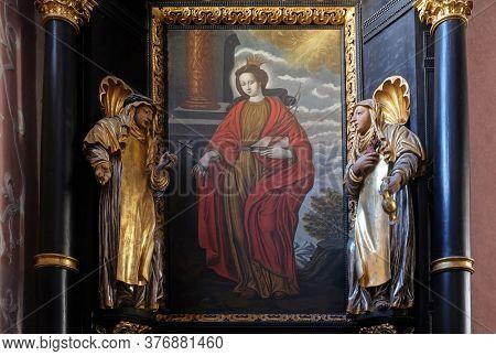 ZAGREB, CROATIA - SEPTEMBER 26, 2018: Altar of Saint Apollonia in the Church of Saint Catherine of Alexandria in Zagreb, Croatia