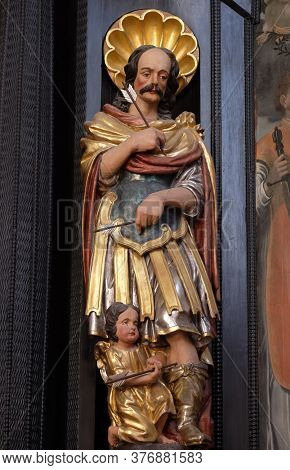 ZAGREB, CROATIA - SEPTEMBER 26, 2018: Saint Sebastian, statue on the altar of Saint Dionysius in the Church of Saint Catherine of Alexandria in Zagreb, Croatia