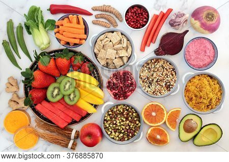 Healthy vegan super food with foods high in antioxidants, anthocyanins, vitamins, minerals, lycopene, protein, smart carbs, omega 3 & fiber. Plant based ethical eating food concept. Flat lay.