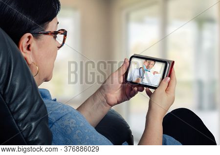 Mature Woman Is Really Interested In Listening To Telemedicine Cardiologist Conclusion On The Screen