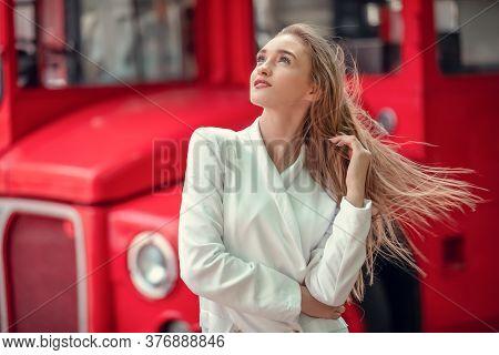 Young Woman Near English Bus. London Red Bus - Girl Enjoying Life. Portrait Of Beautiful Femail Mode