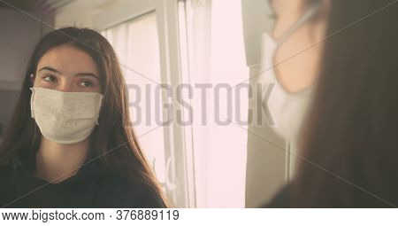 Blurry Backside Brunette Girl Teenager In White Facial Mask Reflects Distinctly In Mirror Standing A