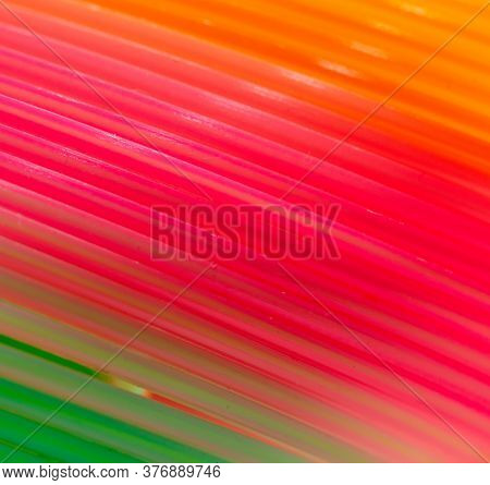 Multi-colored Rainbow Spring As A Background. Children Toy
