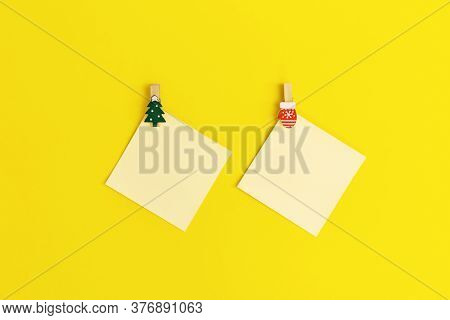 Yellow Paper Memo Notes Decorated Christmas Simbols. Blank Sticky Square Reminder For Writing Wishes
