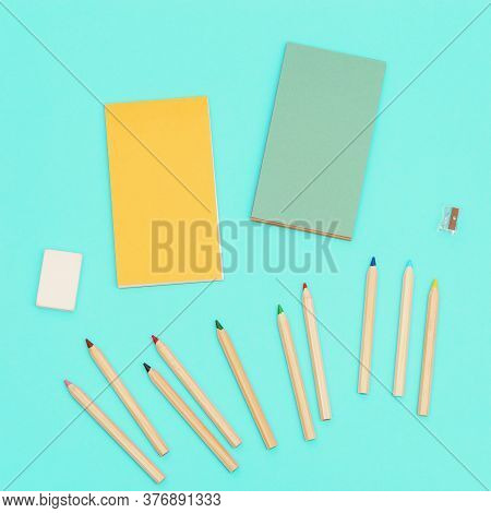 Top View Of Colored Pencils And Sketch Pad For Creativity. Set Of Wooden Multicolored Pencils, Penci