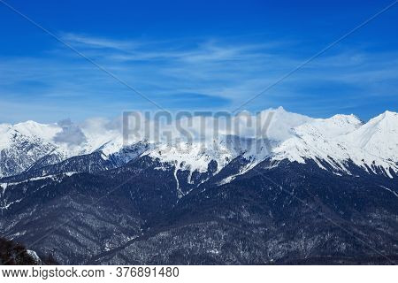 Beautiful Panoramic View Snow Capped Mountains, Russian Beautiful Winter Mountains. Slope For Cross
