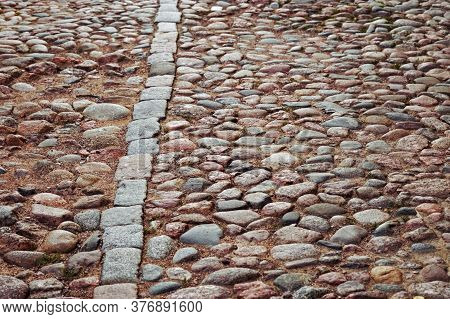 Cobblestone Road. Large Stones On Road. Background From Big Stones. Road Surface. Texture Of Stones.