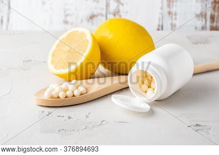 Alternative Medication, Naturopathy, Vitamins And Dietary Supplement. Pills In Form Of Globules And