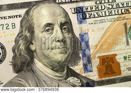 Closeup Abstract Of 100 Bill In Us Currency. Fall Of Us Currency. The Collapse Of The Dollar As The