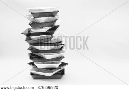 White And Black Foam Food Container Trays (styrofoam Trays) Stacked. Isolated On White Background. C