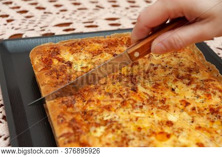 Side View Of Woman Hand Cutting Brazilian Blender Savoury Pie - Traditional Brazilian Food Made With