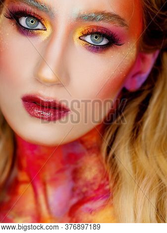 Bright Makeup And Face Art, Close-up Portrait. Creative Makeup, A Radiant Image With Scarlet And Yel