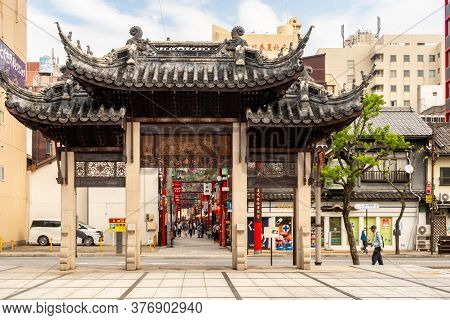 Nagasaki, Japan, 03/11/2019. Nagasaki Wooden Carved Chinatown Gate With Traditional Chinese Roofs An