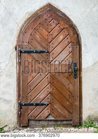 Door From A Medieval Old Buliding. Closed Wooden Door..